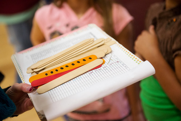 Globe/Roger Nomer<br /> Students in Columbia Elementary's running club use popsicle sticks to keep track of laps.