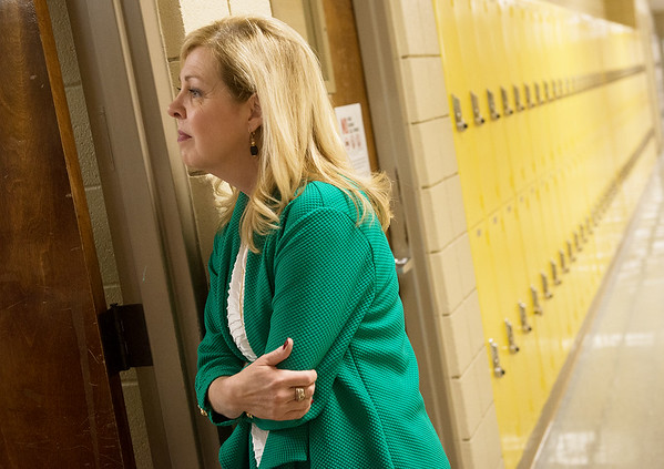 Globe/Roger Nomer<br /> Harrison Superintendent Melinda Moss looks in on a classroom on Friday at Harrison High School.