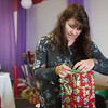 Globe/Roger Nomer<br /> Diana Roland wraps a present at Kenzie Kruisers Wrapping for the Cystic Fibrosis Cure on Wednesday in Carthage. Through Christmas Eve, volunteers will wrap gifts and accept donations for the Cystic Fibrosis Foundation. This is the eighth year for the program, which is located at 2404 Grand in Carthage.