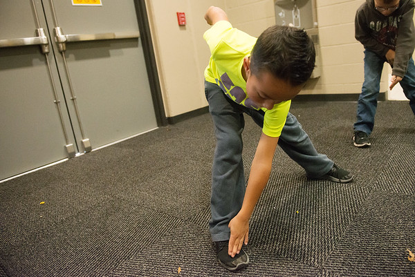 Globe/Roger Nomer<br /> Jensen Stout, second grade, stretches before running on Monday, Dec. 5, at Columbia Elementary.