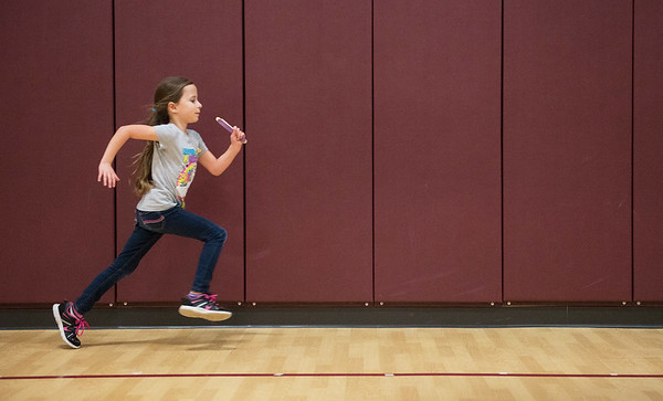 Globe/Roger Nomer<br /> Anissa Spiering, third grade, runs laps on Monday, Dec. 5, at Columbia Elementary.