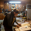 Globe/Roger Nomer<br /> Angie Gastel works on a sled stencil on Friday, Dec. 16, at her studio in Jasper.