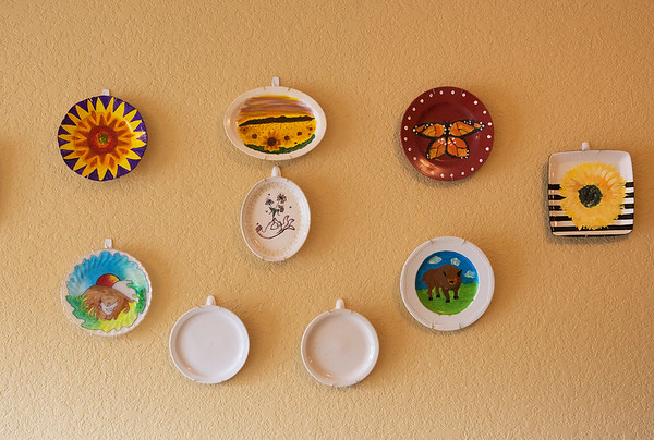 Globe/Roger Nomer<br /> Local artists have pitched in to decorate the walls of the Lord's Dinner with dinner plates.
