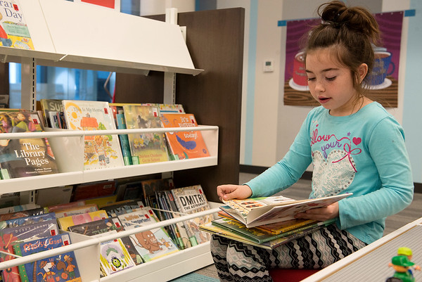 Globe/Roger Nomer<br /> Aliyah Lasiter, 7, Joplin, reads a book on Wednesday at the Joplin Public Library.