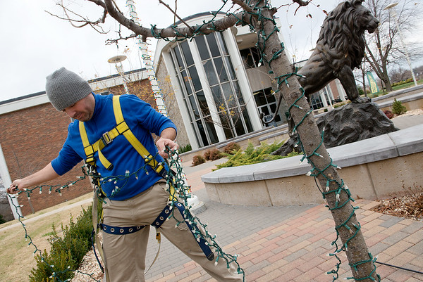 Globe/Roger Nomer<br /> Walter Danna, mechanical and maintenance tech at Missouri Southern, hangs Christmas lights on campus on Monday in preparation for the annual Southern Lights event on Wednesday evening.