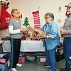 Globe/Anne Brown<br /> Helping to stock the Seneca Food Pantry and Thrift Store are (from left) Doris Mead, Linda Ginger and Russ Ginger.