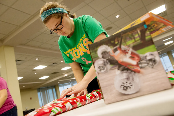 Globe/Roger Nomer<br /> Emily Boyd, a Missouri Southern senior from Carl Junction, wraps a present on Monday at Billlingsly Student Center.