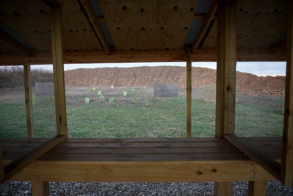 Globe/Roger Nomer<br /> A view down the pistol range at Outdoor Addicts shows berms in place to stop bullets.