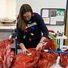 Globe/Roger Nomer<br /> Ashley Kelly volunteers with the Joplin Salvation Army during Thursday's gift distribution.