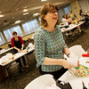 Globe/Roger Nomer<br /> Sharon Fraser, president of Staff Senate at Missouri Southern, wraps a present on Monday at Billingsly Student Center.