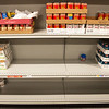 Globe/Roger Nomer<br /> As the holidays approach, many shelves are empty at Crosslines.