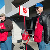 Globe/Roger Nomer<br /> Kiwanis members Kyle Denham, left, and Rod Surber ring bells for the Salvation Army on Saturday at the 15th Street Walmart.