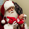 Globe/Roger Nomer<br /> Santa holds Violet Dodson, born Dec. 19, during his visit to the Freeman Hospital NICU on Friday morning. Santa posed for photos with the babies and delivered gifts courtesy of Children's Miracle Network.