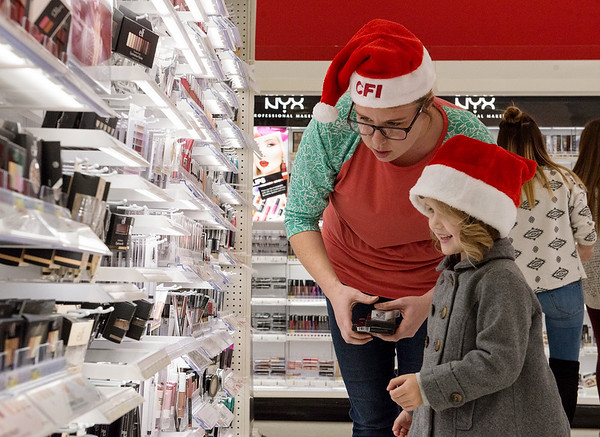 Globe/Roger Nomer<br /> Jamie and Rylee, 4, Thurlow shop for a family on Thursday at Target during the CFI Truckloads of Treasure event.