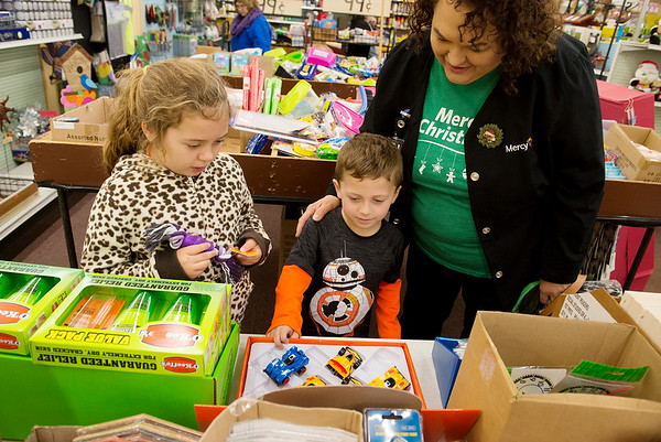 Globe/Roger Nomer<br /> Susan Brown, Joplin, looks at toys with her grandchildren Lily, 7, and Cooper, 5, Rich on Friday at Pearl Brothers Hardware.