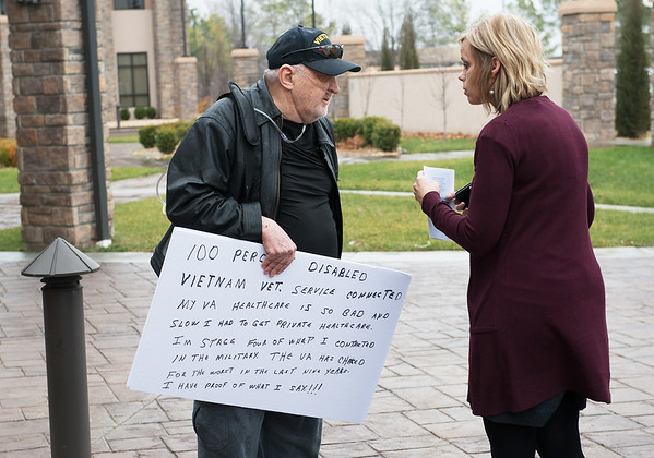 Globe/Roger Nomer<br /> Wanda Shull, public affairs officer for the Department of Veterans Affairs, listens to Albert Spratley's concerns while he protests at the construction kick off of the outpatient clinic on Tuesday. Shull asked Spratley to attend the kick off but to put away his signs while on private property, which he agreed to do.