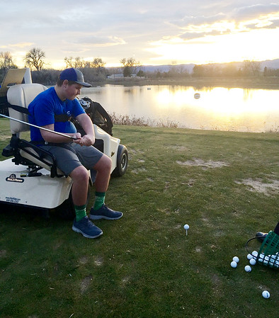 Contributed Photo<br /> Grant Trent hits a golf ball from an adaptive golf cart while participating in a rehab recreational activity with Craig Hospital in Colorado.