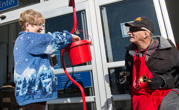 Globe/Roger Nomer<br /> William Whittenback talks with Mary Deleon as she donates to the Salvation Army on Saturday at the Walmart on Seventh Street.