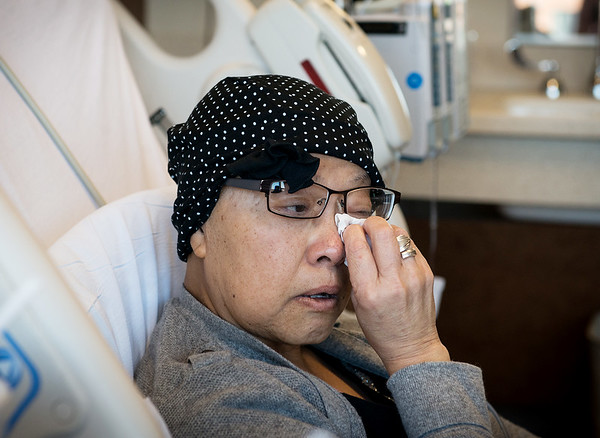 Globe/Roger Nomer<br /> Kristine Mcculley wipes away tears as she talks about support from her family and friends through her time with lymphoma during an interview on Monday at The University of Kansas Hospital.