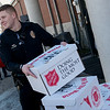 Globe/Roger Nomer<br /> Joplin Police Officer Jacob Wright volunteers for food distribution on Thursday at the Joplin Salvation Army.