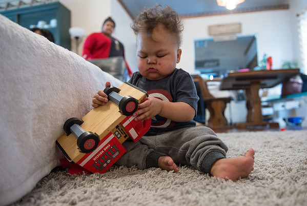 Globe/Roger Nomer<br /> Rohen Reeves plays with a firetruck on Saturday in Joplin.