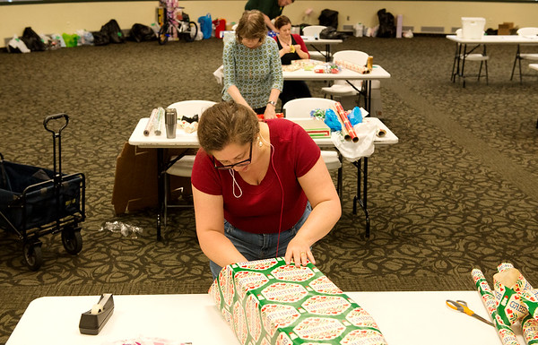 Globe/Roger Nomer<br /> Camara Koich, a Missouri Southern student from Joplin, wraps a present on Monday at Billingsly Student Center.