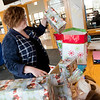 Globe/Roger Nomer<br /> Kayla Monteleone, graphic designer at Crowder College, packs Angel Tree gifts on Tuesday at Crowder in Neosho.