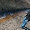 Globe/Roger Nomer<br /> Rebecca Jim looks at runoff near Tar Creek on Tuesday.