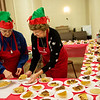 Globe/Roger Nomer<br /> Gaye Pate, left, and Ruth Kost prepare a table of desserts on Monday at First Community Church in Joplin.