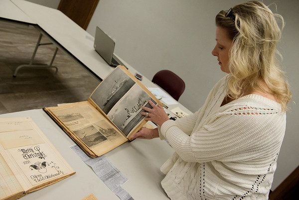 Globe/Roger Nomer<br /> Tausha Johnson talks about her grandfather's collection of Pearl Harbor papers, including a Christmas menu from the USS Oklahoma where he was stationed.