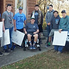Contributed Photo<br /> Friends hold a surprise welcome home party for Grant Trent, center, at his home in Carthage on Dec. 2.