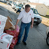 Globe/Roger Nomer<br /> Scott Ruse, a Salvation Army cadet from Chicago, helps with food distribution on Thursday at the Joplin Salvation Army.