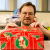 Globe/Roger Nomer<br /> Kyle Vann, event support coordinator for the IT Department at Missouri Southern, wraps a present on Monday at the Billingsly Student Center.