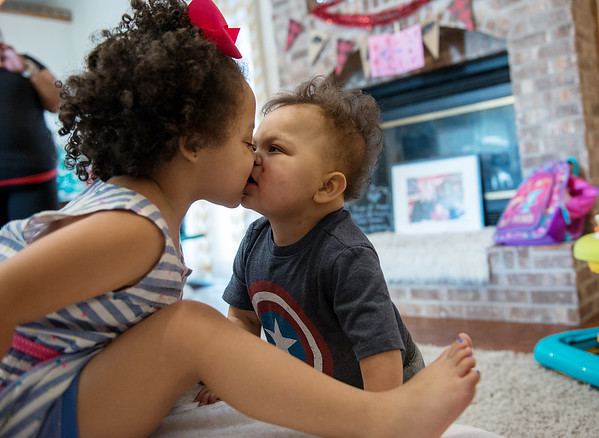 Globe/Roger Nomer<br /> Rielynn Reeves, 3, surprises her brother Rohen, 2, with a kiss on Saturday in Joplin.
