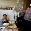 Globe/Roger Nomer<br /> Kristine Mcculley rests while Kathy Gaillard, registered nurse, administers the Yescarta treatment on Monday at The University of Kansas Hospital.