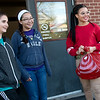 Globe/Roger Nomer<br /> (from left) Parker Leas, Victoria Henson-Miyauchi and India Robinson greet visitors to the Joplin Salvation Army on Thursday during gift and food distribution.