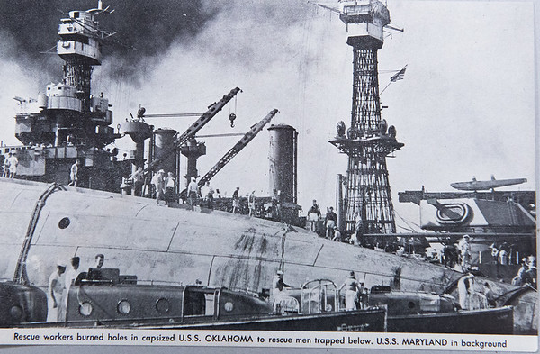 Government photo of the rescue efforts on the USS Oklahoma following Pearl Harbor