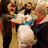 Globe/Roger Nomer<br /> Helen Scales preps delivery meals for the father son delivery team of Neal, center, and Dan Sellers on Monday at First Community Church in Joplin.