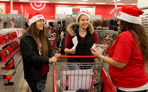 Globe/Roger Nomer<br /> (from left) Shahla, 15, Cheyenne and Sohaila Kellhofer shop for a family on Thursday at Target during the CFI Truckloads of Treasure event. Sohaila Kellhofer is a publishing supervisor for CFI.