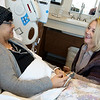 Globe/Roger Nomer<br /> During her treatment on Monday, Kristine Mcculley talks with her sister Georgia Burleson, of Denver, at The University of Kansas Hospital.