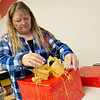Globe/Roger Nomer<br /> Bellaree Blackford wraps a gift on Wednesday as part of the annual Kenzie's Kruisers Wrapping for a Cystic Fibrosis Cure. The group wraps presents in exchange for a suggested donation to the Cystic Fibrosis Foundation. They will be open through Christmas Eve at 2404 Grand in Carthage.