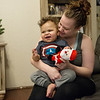 Globe/Roger Nomer<br /> Amanda Reeves holds her son Rohen, 2, on Saturday in their home in Joplin.