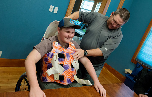 Globe/Roger Nomer<br /> Scott Trent shows the hard shell that his son Grant had to wear during his rehab time at Craig Hospital in Colorado, during an interview on Dec. 13 at their home.