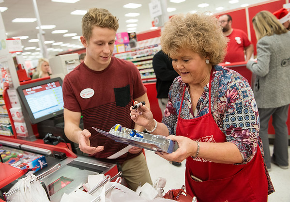 Globe/Roger Nomer<br /> Brian Chrun and Kathy Smith, a volunteer with Joplin Salvation Army, bag items on Thursday at Target during the CFI Truckloads of Treasure event.