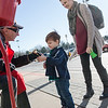 Globe/Roger Nomer<br /> William Whittenback lets Justin Binder, 3, try his hand at bell ringing as his mother Ali looks on at the Walmart on Seventh Street on Saturday.