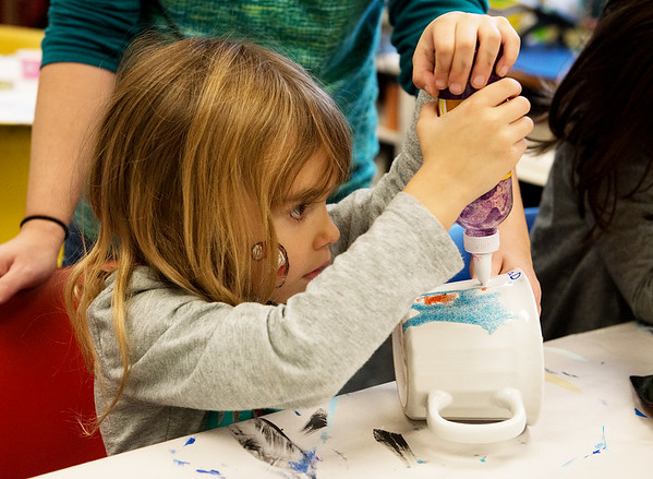 Globe/Roger Nomer<br /> Audri Hamlet, 5, Joplin, decorates a mug for her father on Wednesday during the Holiday Workshop at the Spiva Center for the Arts.