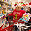 Globe/Roger Nomer<br /> Shelly Smith, left, an administrative assistant at CFI, and Shelley Pruitt, a benefits specialist at CFI, shop for families on Thursday at Target during the CFI Truckloads of Treasure event.
