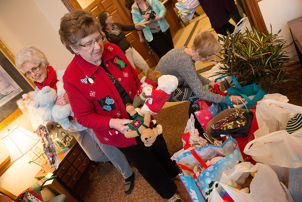(from left) Betty Buckner, RuthAnn Hodson and Earline Kelley deliver presents to the Ronald McDonald House of the Four States on Friday. Volunteers with the Freeman Auxiliary collected gifts to donate to children and also essential items to give to parents staying at the House.<br /> Globe | Roger Nomer