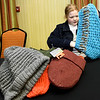 Thirteen-year-old Jackie Wiese helps tag new scarves, hats and gloves for distribution throughout the Joplin community as part of the Chase the Chill program on Thursday night at Homewood Suites. Volunteers will distribute more than 1,000 items as part of the program, which is in its fourth year.<br /> Globe | Laurie Sisk