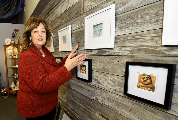 Urban Art gallery owner Linda Teeter talks about the importance of an arts district - especially to up and coming artists -  at the gallery on Thursday. Teeter is lobbying for an arts district in Joplin.<br /> Globe | Laurie Sisk